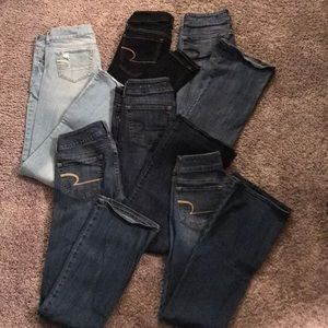 6 pair of American Eagle jeans